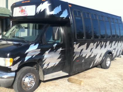 Arrive in style in our Black Party Limo Bus!